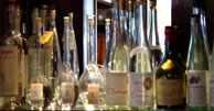 Oregon eau de vie line the back bar at Higgins
